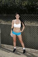 Hot babe Noelle Easton posing outdoors in sports bra and short shorts