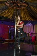 MILF Cathy Heaven grinding against stripper pole before getting naked atop bar
