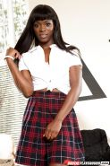 Afrikan solo girl Ana Foxxx removing schoolgirl uniform to pose naked