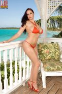 Brunette MILF Gianna Rossi unleashing nice melons from bikini on balcony