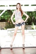 Anorexic young girl Jenna Justine siding short denim shorts over long legs