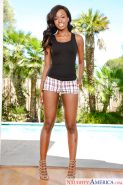 Ebony dime Jezabel Vessir showing off sexy legs in shorts beside pool