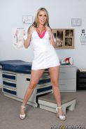 Busty MILF with a big ass Courtney Cummz poses in doctor's uniform
