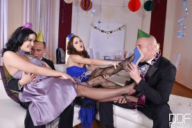 Leggy chicks Tina Kay and Dolly Diore remove stockings to give footjob