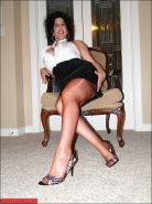 Curvy mature demonstrating her hooters and legs in retro nylon stockings