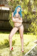 Blue haired babe Gigi Allens freeing big tits from bikini top beside pool