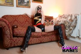 Blonde babe Xena Wilkes baring nice tits from underneath cosplay uniform