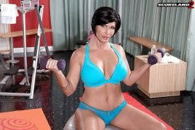Dark haired MILF Shay Fox baring large boobs before finger fucking in gym