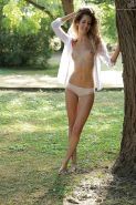 Skinny solo chick Monique Woods shows off tiny tits and bald slit in woods