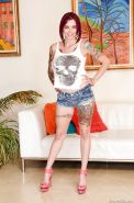 Tattooed redhead Anna Bell Peaks in shorts shows hot ass & big fake tits