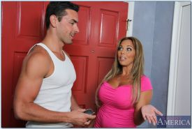 Hot MILF with big round tits Amber Lynn Bach gives a blowjob and gets shagged