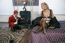 Blonde MILF Phoenix Marie fucking hung bellboy in black stockings