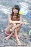 Petite teen babe Mia D exhibiting tiny tits and bald slit outdoors in woods #52245192