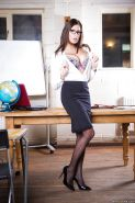 Glasses adorned brunette solo girl Sensual Jane reveals big tits in office