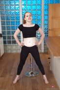Mature Euro redhead Tia Jones slips off yoga pants to spread hairy snatch