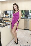 Seductive MILF Maria Bellucci gets rid of her dress and lingerie top