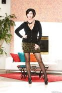 Buxom MILF Shay Fox posing solo in black panties and stockings