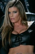 Big titted MILF Kristal Summers stripping off her latex lingerie