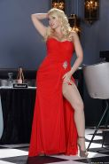 Blonde pornstar Kagney Linn Karter showing off in a red dress