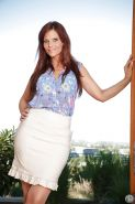 Big tits redhead Syren De Mer is undressing for her fans on camera