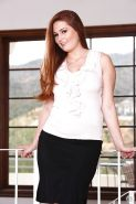 Chubby redhead mom Allison Moore posing fully clothed in nylons and garters