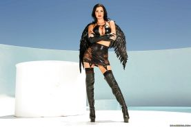 Bog boobed Angel Jasmine Jae strutting in thigh high boots and garters