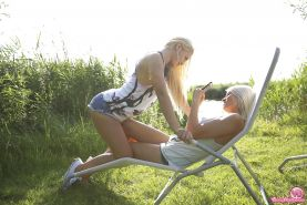 Beautiful blonde teenagers undress for lesbian sex in the woods