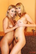Horny lesbian Nikky Thorne fisting her busty friend's pussy