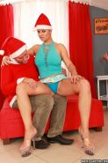 Alexa Bold shows off her big natural tits and shaved pussy on Santa's knee
