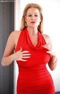 Big tits blonde babe Kelly Madison is posing in her red skirt