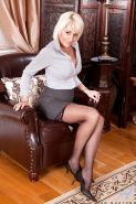Horny office MILF lady Jan Burton shows us her hot mature body in short skirt and black stockings.