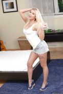 Young blonde girl Marsha May licking panties after peeling them off on bed