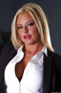 Working blonde Britney Shannon demonstrates her big tits in office