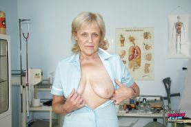 Blonde granny in nurse uniform getting horny sitting on gynochair