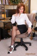 Mature office secretary Roni flashing tits and pussy in black stockings
