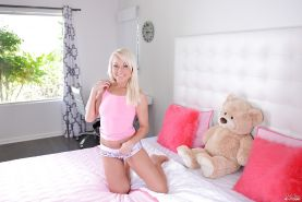 Blonde teenager Valerie White showing off pierced nipples and bald twat