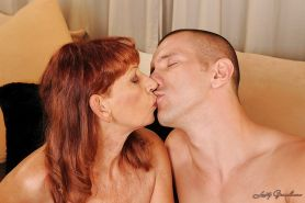 Slutty granny with tiny tits kissing and fucking with a hot guy