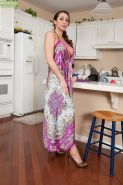 Pretty milf with big tits Kaylynn exposes her treasures at the kitchen