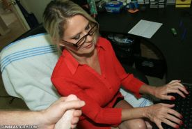 Fully clothed mature blonde in glasses gives a handjob and gets bukkaked