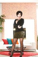 Latina solo babe Shay Fox posing fully clothed in skirt and nylons
