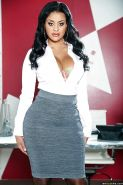 Chesty Latina Mary Jean posing fully clothed in business uniform and heels