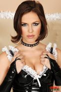 Gorgeous babe Bobbi Starr dressed in latex uniform strips naked