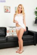 Young blonde amateur Taylor Whyte flashing her white underwear on couch