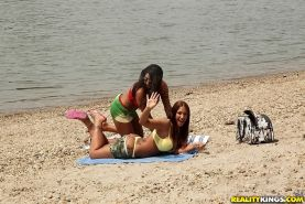 Lesbian babes Kyra Hot and Candy Coxx are having amazing time outdoor