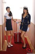 Leggy stewardesses remove high heels and uniforms for threesome footjob