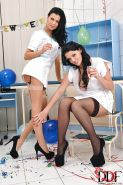 Lesbian milfs Emma Leigh and Jasmine Jae play with bottle of wine