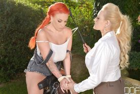 LiLy Madison and blonde Angel Wicky fucks in BDSM style outdoors