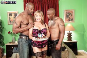 Two black dudes fuck a dirty-minded granny fill her cunt with black cocks