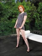 Sexy redhead Justine Joli flashes panty upskirt in back yard & toys with dildo