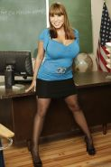 Milf teacher Ava Devine is showing her tight pussy in sexy stockings